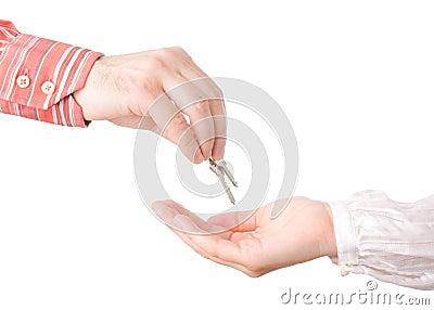 Hands passing house keys