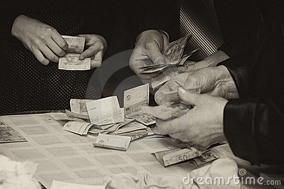Hands of people holding money