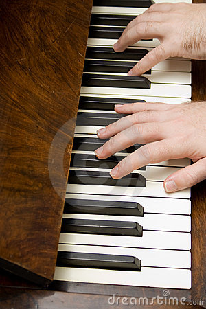Hands of person playing piano