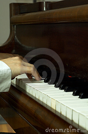 Hands of a Pianist at the Piano