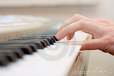 Hands and piano player