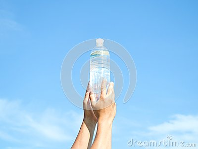 Hands with  plastic bottle of water