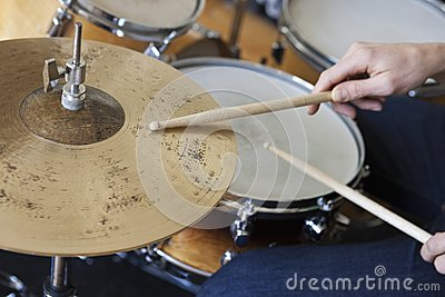 Hands Playing Drum Set