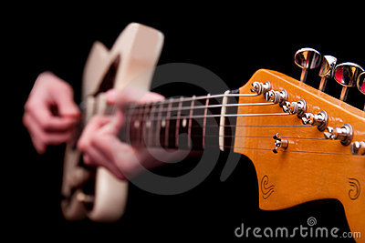 Hands playing guitar string music