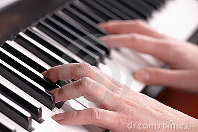 Hands playing music on the piano