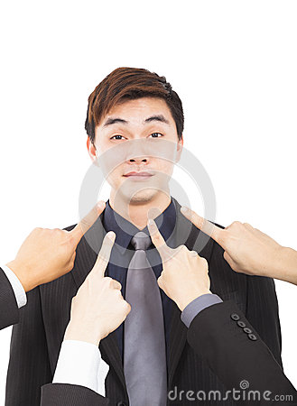 Hands pointing towards businessman