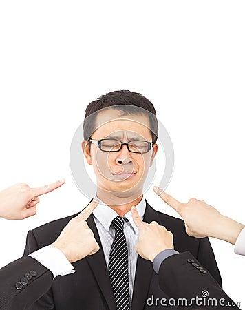 Hands pointing towards sadness businessman