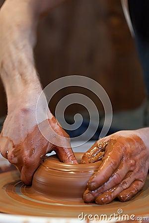Hands of a potte