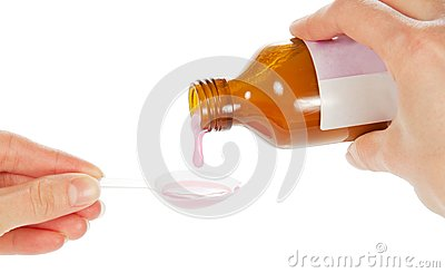 Hands pour pink medicine in a spoon