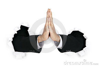 Hands of praying businessman