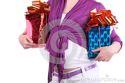 Hands of pregnant woman holding boxes with gift