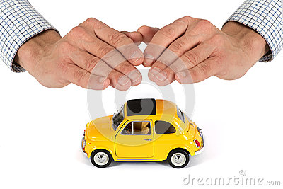 Hands Providing Protection Over Yellow Toy Car