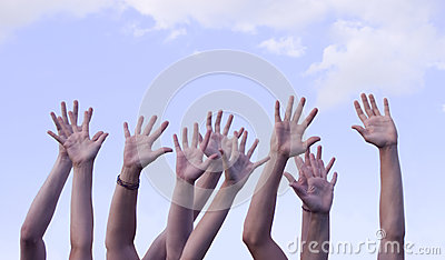 Hands Raised in Air Against Sky