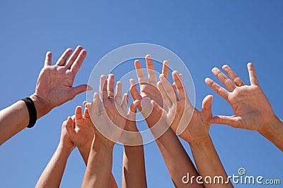 Hands raised sky to