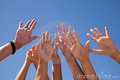 Hands raised to the sky