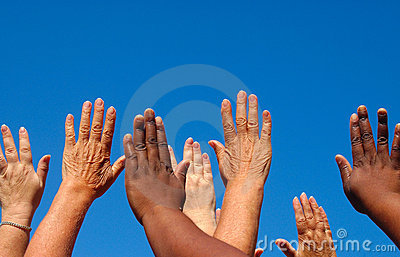 Hands raised together