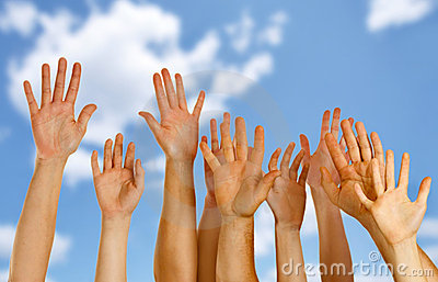 Hands raised up in air