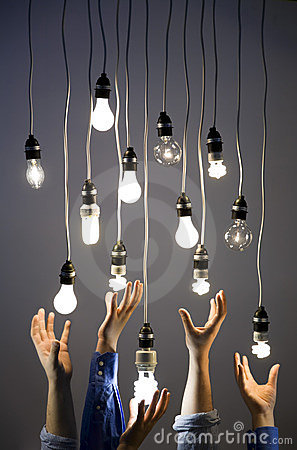 Hands reaching for light bulbs