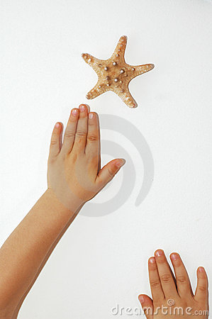 Hands reaching star