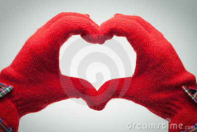 Hands in red gloves show heart shaped sign