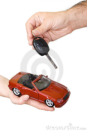 Hands with red sports car and key
