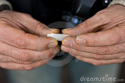 Hands rolling tobacco