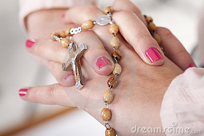 Hands with a rosary