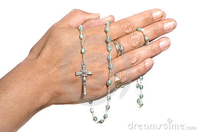 Hands and rosary beads