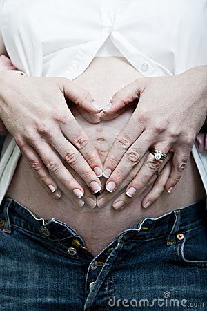 Hands rubbing pregnant belly