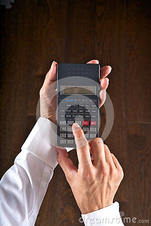 Hands with scientific calculator