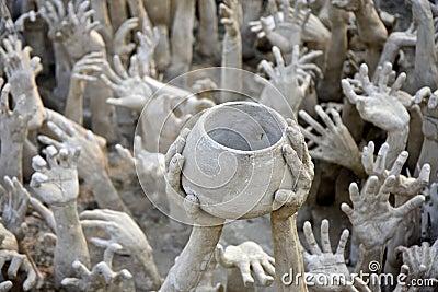 Hands sculpture at Wat Rong Khun temple, Thailand