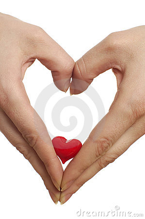 Hands shaping heart with a heart of glass