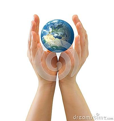 Hands sheltering tiny globe facing Europe