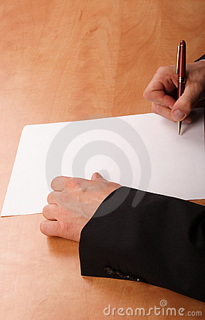 Hands signing blank paper