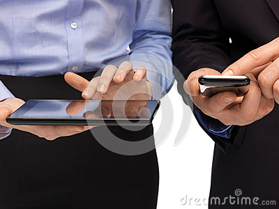 Hands with smartphones and tablet pc