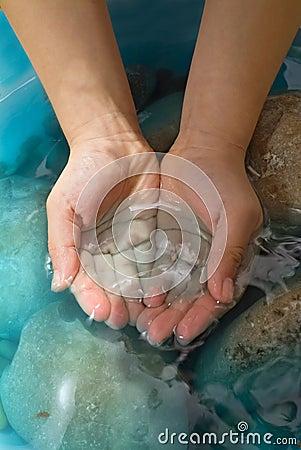 Hands stones water