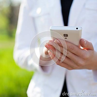 Hands using smartphone Stock Photo