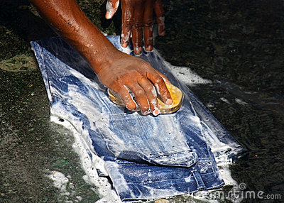 Hands wash the jeans