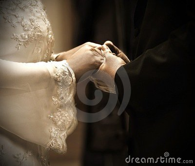 Hands in wedding ceremony