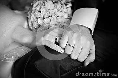 Hands with wedding gold rings