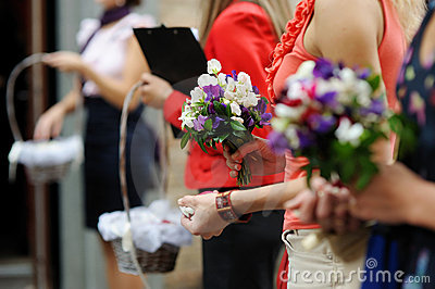 Hands of a woman full of rose petals