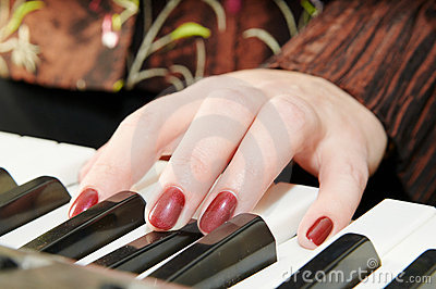 Hands of a woman playing piano