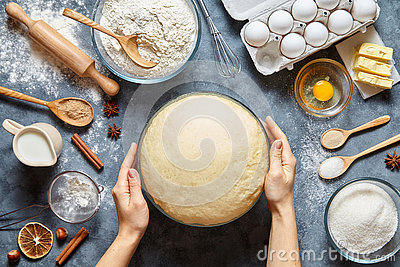 Hands working with dough preparation recipe bread, pizza or pie making ingridients, food flat lay Stock Photo
