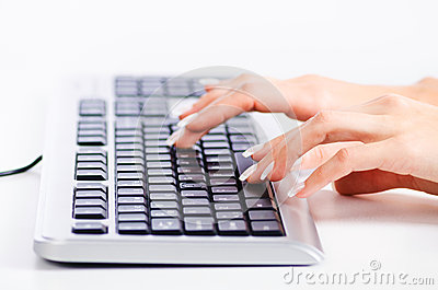 Hands working on  keyboard