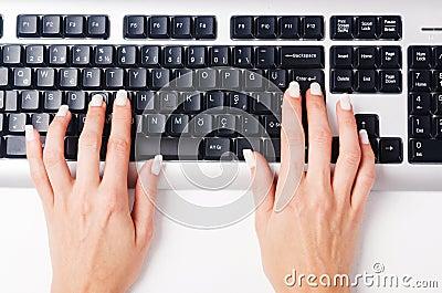 Hands working on  keyboard