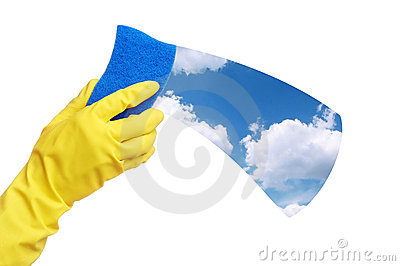 Hands in yellow glove with sponge