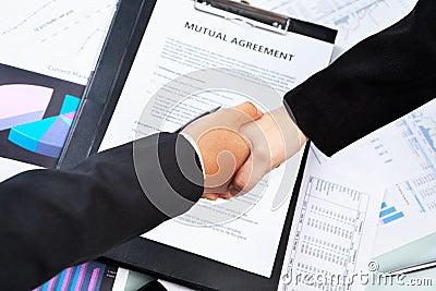 Handshake btween businesswoman over agreement