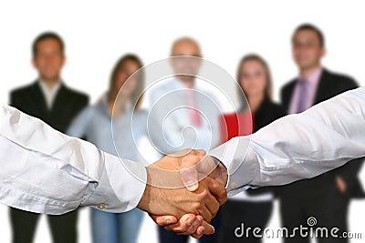 HANDSHAKE AND BUSINESS TEAM