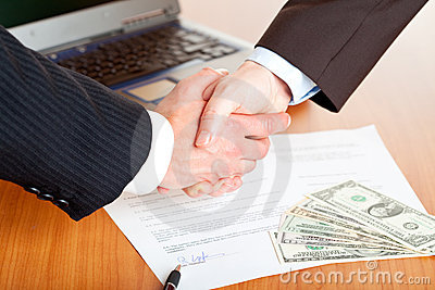 Handshake of businessmen after
