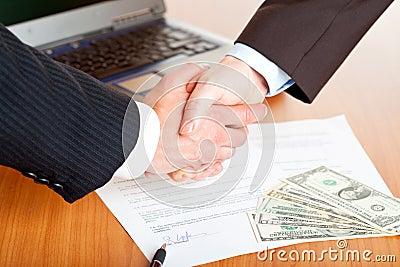 Handshake of businessmen after